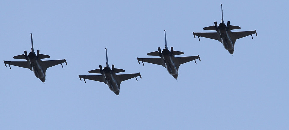 Photo - F-16s from the 138th Fighter Wing, an Oklahoma Air National Guard unit out of Tulsa, perform a flyover Monday at the Midwest City  Veterans Day parade. Photos by Jim Beckel, The Oklahoman