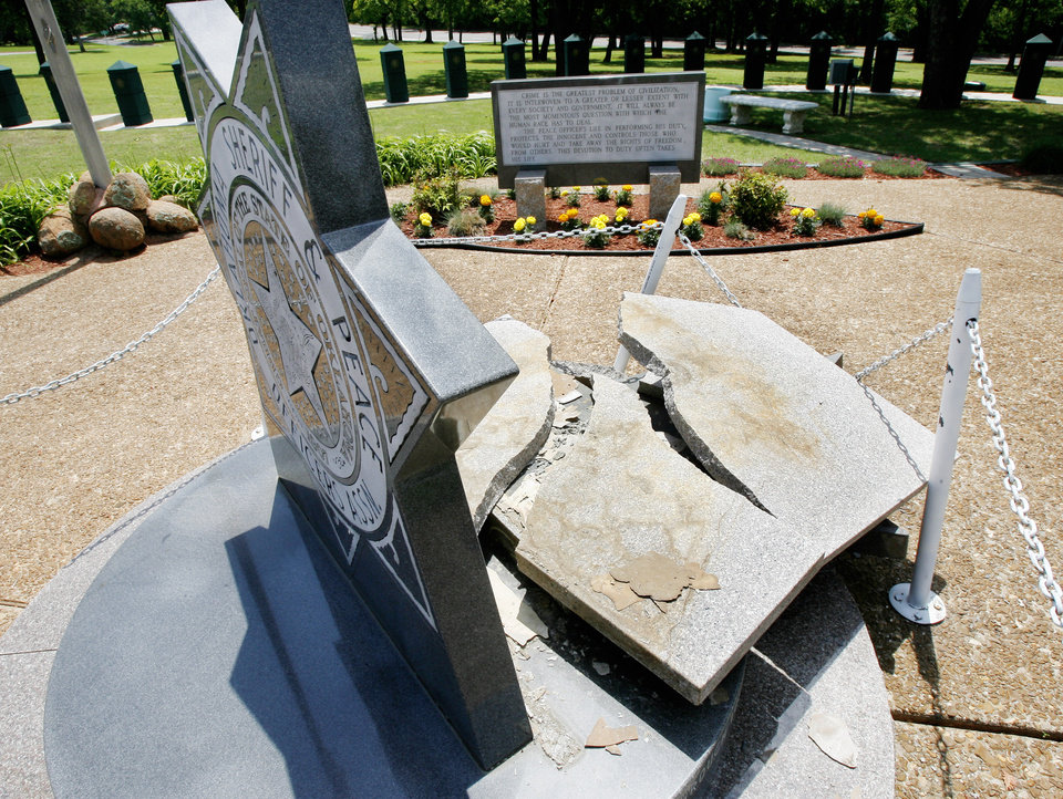 Photo - STORM DAMAGE: Section of the Oklahoma Law Enforcement Officers Memorial Service damaged by high winds on the grounds of the Department of Public Safety offices at NE 36 and MLK Street in Oklahoma City Wednesday, May 13, 2009. Photo by Paul B. Southerland, The Oklahoman ORG XMIT: KOD