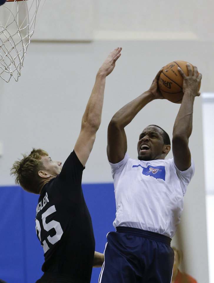 Photo - Oklahoma City Thunder's Michael Snaer, right, takes a shot over Detroit Pistons' Kyle Singler, left, during an NBA summer league basketball game, Tuesday, July 9, 2013, in Orlando, Fla. (AP Photo/John Raoux) ORG XMIT: DOA110