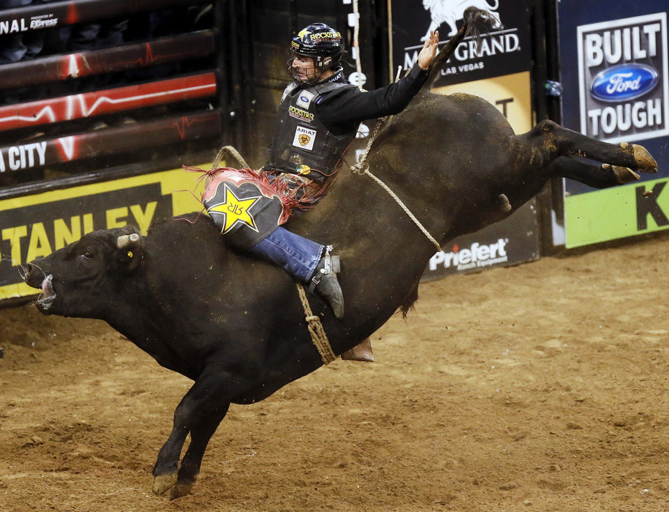 Sean Willingham rides Bring It On to an 87.5  during the WinStar World Casino Invitational PBR bull riding event at Chesapeake Energy Arena in Oklahoma City, Friday, Jan. 25, 2013. Photo by Nate Billings, The Oklahoman