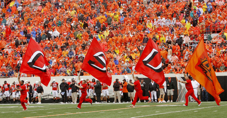 Photo - Cheerleaders run the flags out after another Cowboy TD at the Oklahoma State University (OSU) football game against Missouri State University (MSU) Saturday Sept. 13, 2008 at Boone Pickens Stadium in Stillwater, Okla. BY DOUG HOKE, THE OKLAHOMAN.