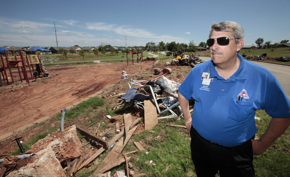 Photo - Moore Emergency Management Director Gayland Kitch is shown at Veterans Memorial Park in Moore as clean up continues following the EF5 tornado on May 20.   David McDaniel - The Oklahoman