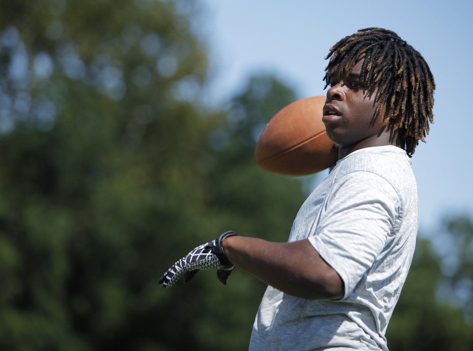 COLLEGE FOOTBALL: Casey Curtis throws a football during a practice at Northeastern Oklahoma A&M College in Miami, Okla., Wednesday, July 18, 2012. Photo by Garett Fisbeck, The Oklahoman