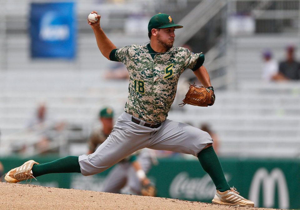 Photo - Southeastern Louisiana pitcher Tate Scioneaux throws in the bottom of the first inning against Bryant during an NCAA college baseball regional tournament game in Baton Rouge, La., Saturday, May 31, 2014. (AP Photo/Derick Hingle)