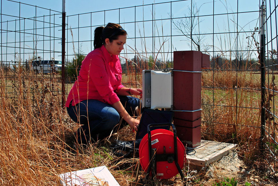 Photo - Garber-Wellington Aquifer. Jessica at the Spencer Mesonet Groundwater Well.