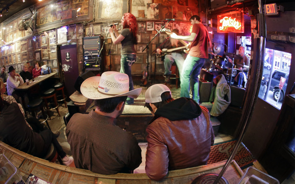 This Jan. 15, 2014 photo shows Tootsie\'s Orchid Lounge on Lower Broadway in Nashville, Tenn. Most of the bars on lower Broadway are free from cover charges, although it's always good to tip the band when they pass the bucket around. (AP Photo/Mark Humphrey)