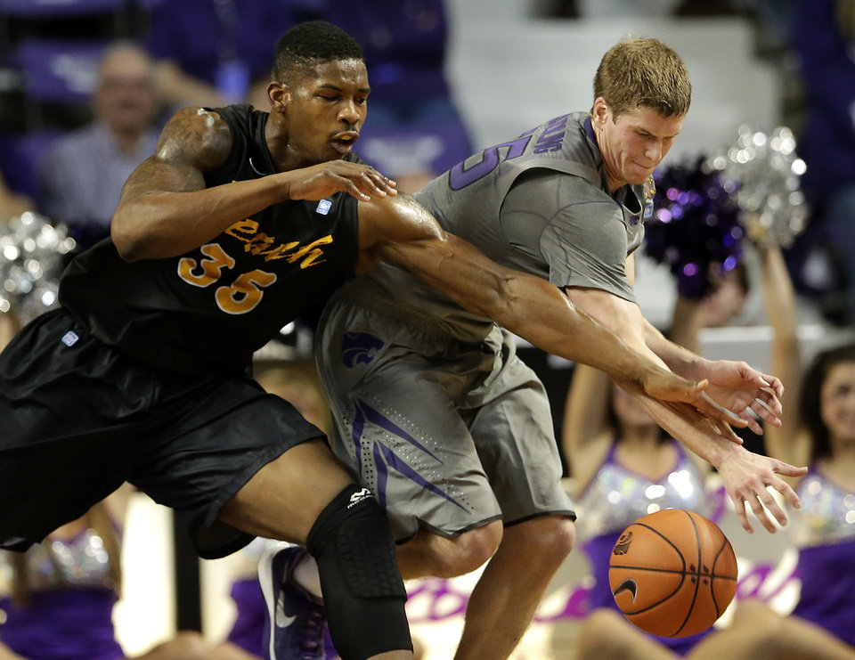 Photo - Kansas State's Will Spradling, right, and Long Beach State's Dan Jennings (35) chase a loose ball during the first half of an NCAA college basketball game Sunday, Nov. 17, 2013, in Manhattan, Kan. (AP Photo/Charlie Riedel)