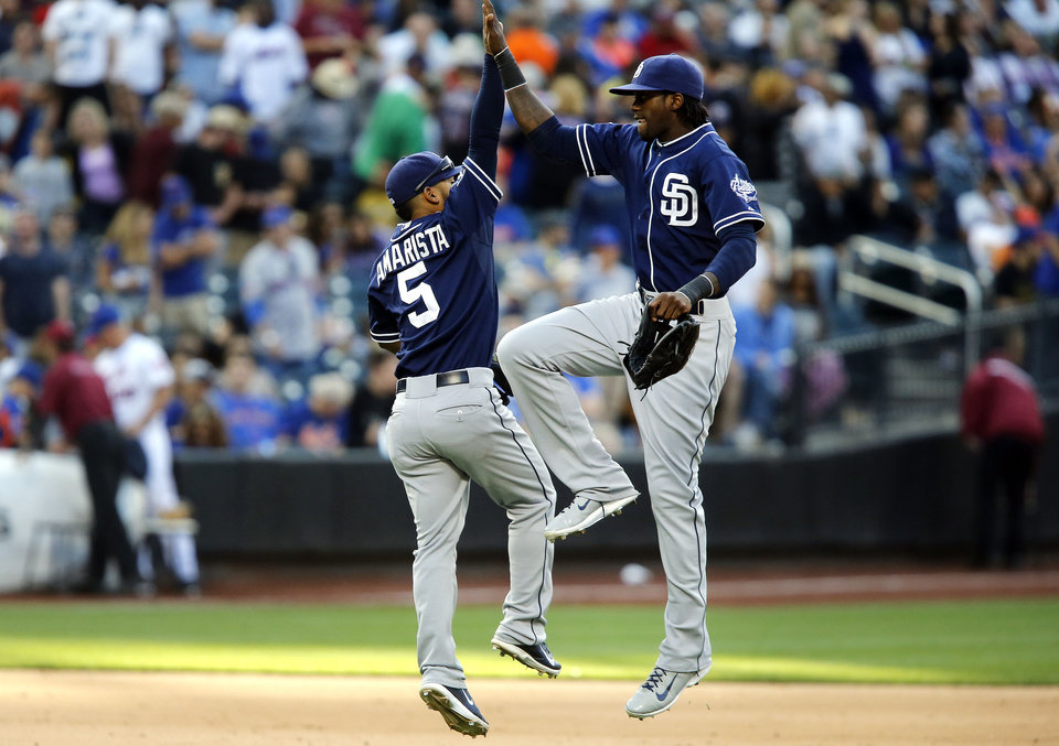 Photo - San Diego Padres' Alexi Amarista, left, and Cameron Maybin celebrate at the end of the ninth inning of a baseball game against the New York Mets, Saturday, June 14, 2014, in New York. San Diego won 5-0. (AP Photo/Jason DeCrow)