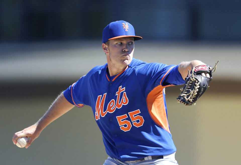 Photo - New York Mets starting pitcher Noah Syndergaard (55) throws during the first inning of a spring training baseball game against the Detroit Tigers in Lakeland, Fla., Saturday, March 8, 2014. (AP Photo/Carlos Osorio)