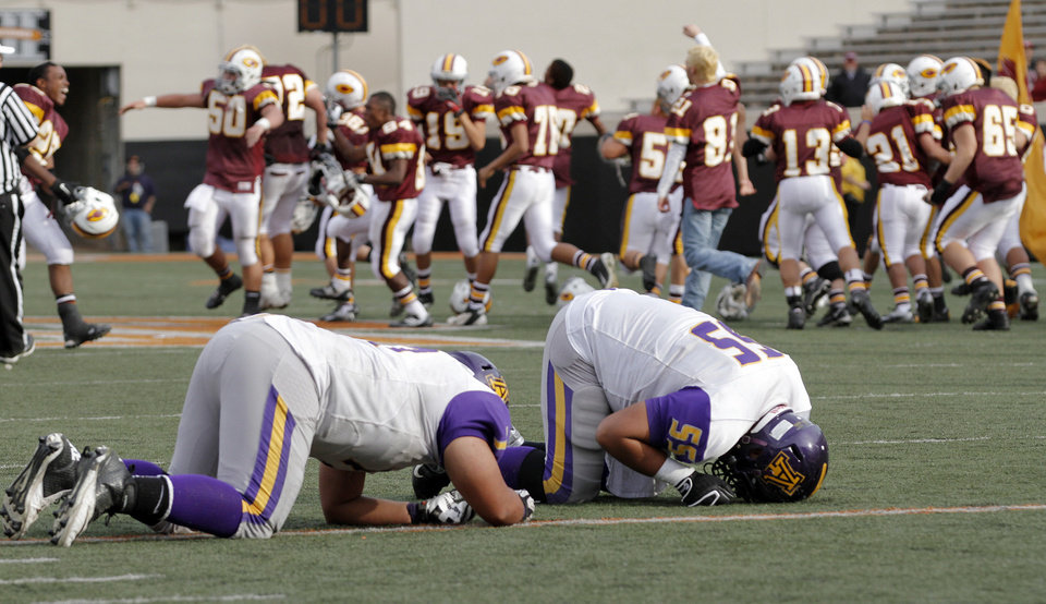 Anadarko\'s Dakota Botone (77) and James Paddlety (55) react after the 21-14 loss to Clinton during the Class 4A Oklahoma state championship football game between Anadarko and Clinton at Boone Pickens Stadium on Saturday, Dec. 1, 2012, in Stillwater, Okla. Photo by Chris Landsberger, The Oklahoman