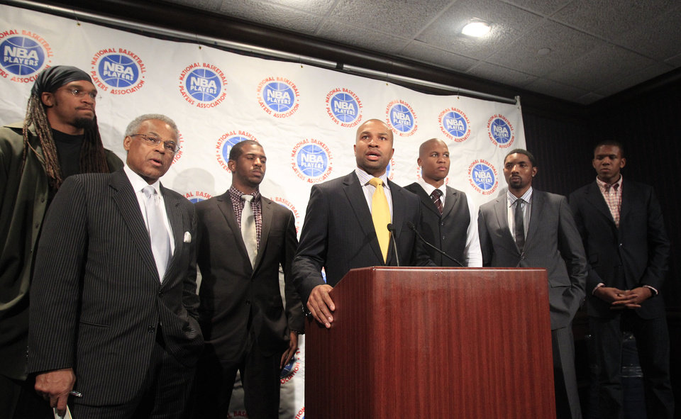 Photo - As Derek Fisher, center, president of the NBA players union, speaks during a news conference, Etan Thomas, Billy Hunter, Chris Paul, Maurice Evans, Roger Mason Jr. and James Jones, from left, listen after NBA labor talks ended Thursday, Oct. 20, 2011, in New York. After 30 hours of negotiations over three days, the two sides remained divided over two main issues--the division of revenues and the structure of the salary cap system. (AP Photo/Frank Franklin II) ORG XMIT: NYFF110