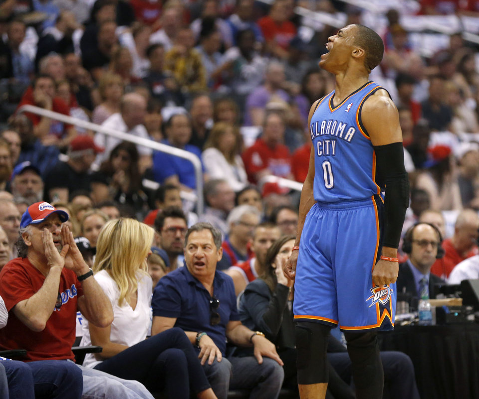 Photo - Oklahoma City's Russell Westbrook (0) celebrates during Game 4 of the Western Conference semifinals in the NBA playoffs between the Oklahoma City Thunder and the Los Angeles Clippers at the Staples Center in Los Angeles, Sunday, May 11, 2014. Photo by Nate Billings, The Oklahoman