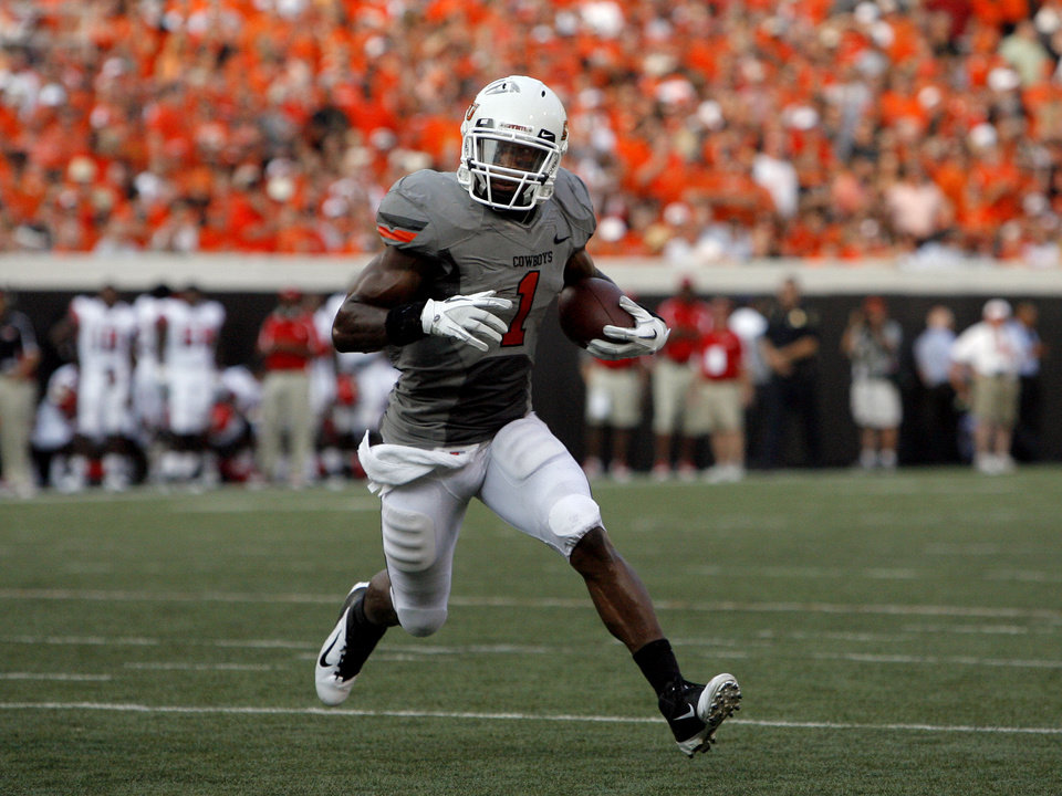 Photo - Oklahoma State's Joseph Randle runs toward the end zone during the Cowboys' 64-31 win in Stillwater. Photo by Sarah Phipps, The Oklahoman