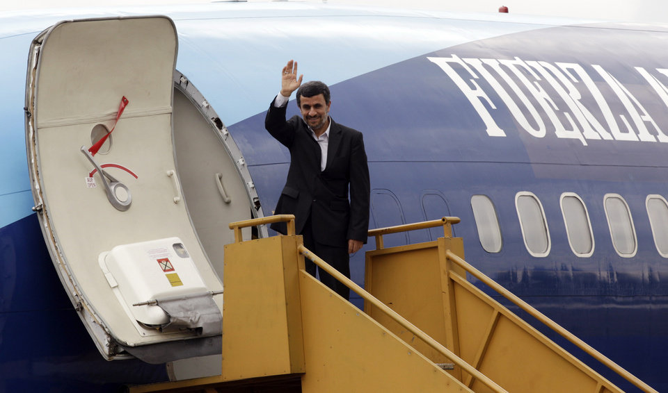 Iran's President Mahmoud Ahmadinejad waves to reporters from his air plane at an air base as he departs Quito, Ecuador, Friday Jan. 13, 2012.  Ecuador was the final stop in his four-nation Latin America visit. (AP Photo/Dolores Ochoa) ORG XMIT: DOR103