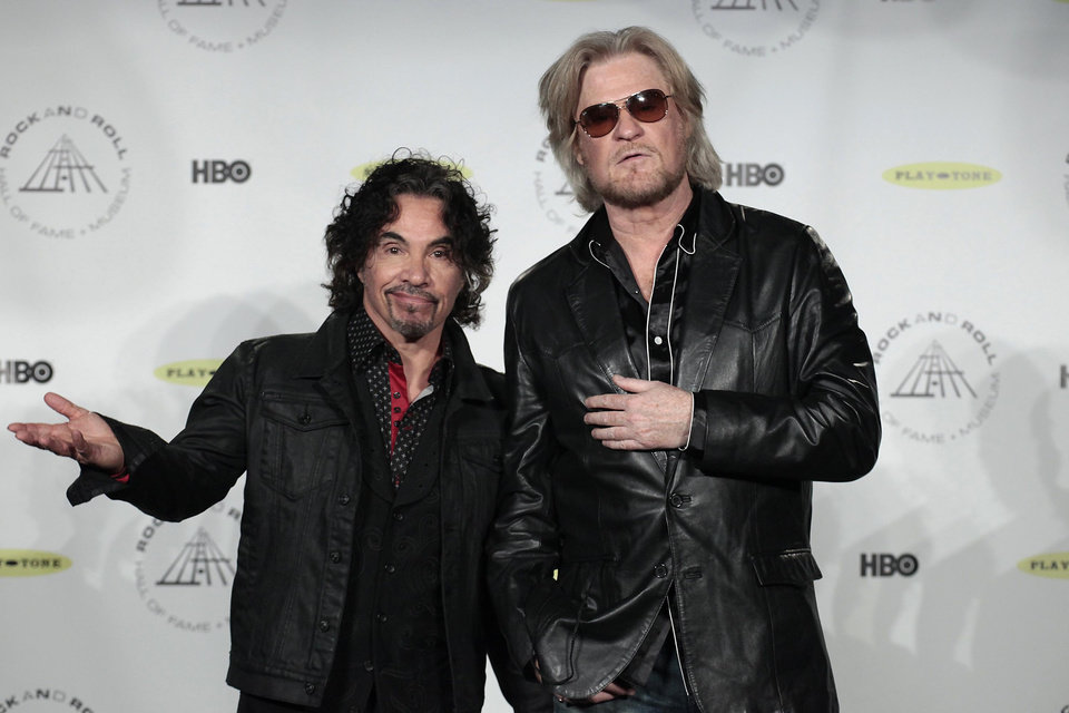 Photo - Hall of Fame Inductees John Oates and Daryl Hall appear in the press room at the 2014 Rock and Roll Hall of Fame Induction Ceremony on Thursday, April, 10, 2014, in New York. (Photo by Andy Kropa/Invision/AP)