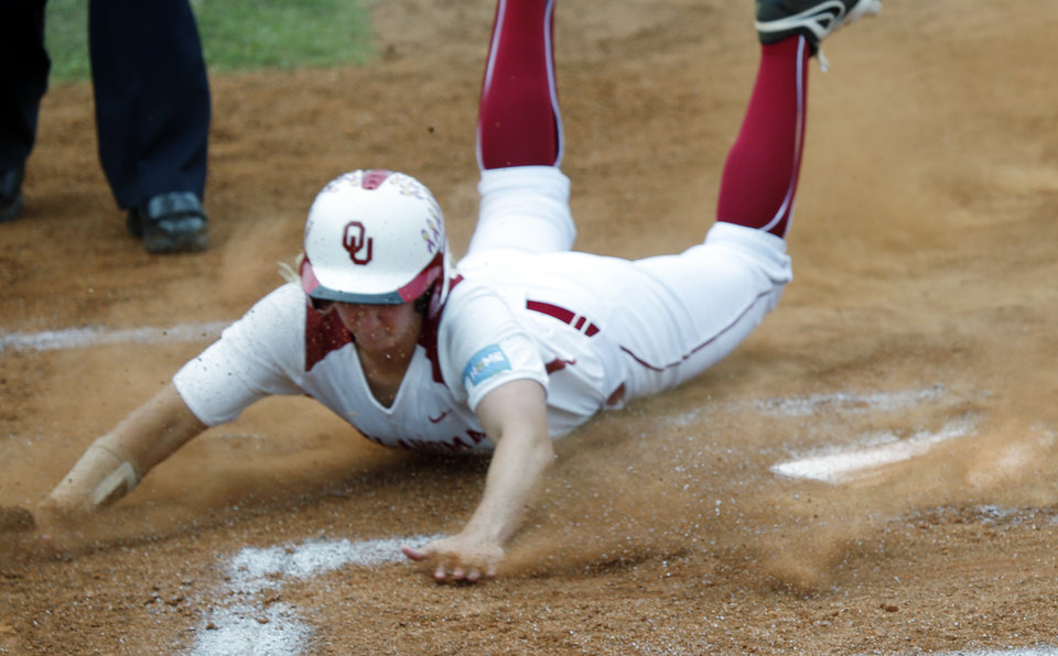 Photo -                    OU's Shelby Pendley scores the first run of the game against Texas A&M at the Norman Regional on Saturday. Pendley hit two home runs in the Sooners' 9-8 come-from-behind win.                                       Photo by Steve Sisney, The Oklahoman