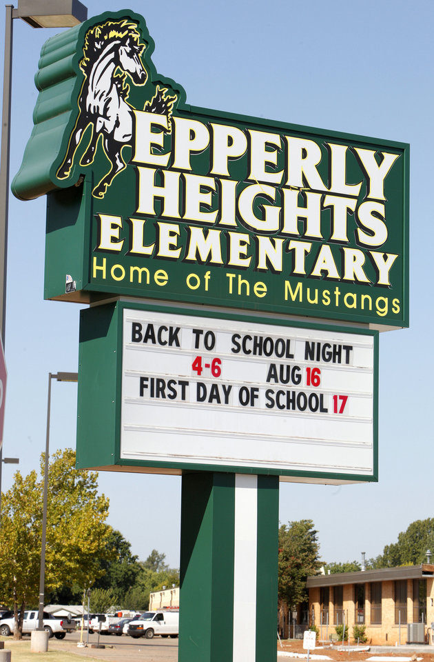 Photo - A sign at Epperly Heights Elementary in Del City reminds students and parents what's coming.