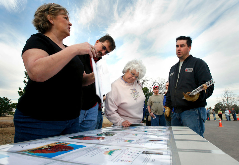 Bonny Million, Richard Griffitts, and Pauline Roby talk with Norman maintenance worker Phillip Brooks as they pass a table displaying the trees the city is giving to residents in Norman, Oklahoma on Thursday, March 13, 2008.    BY STEVE SISNEY, THE OKLAHOMAN