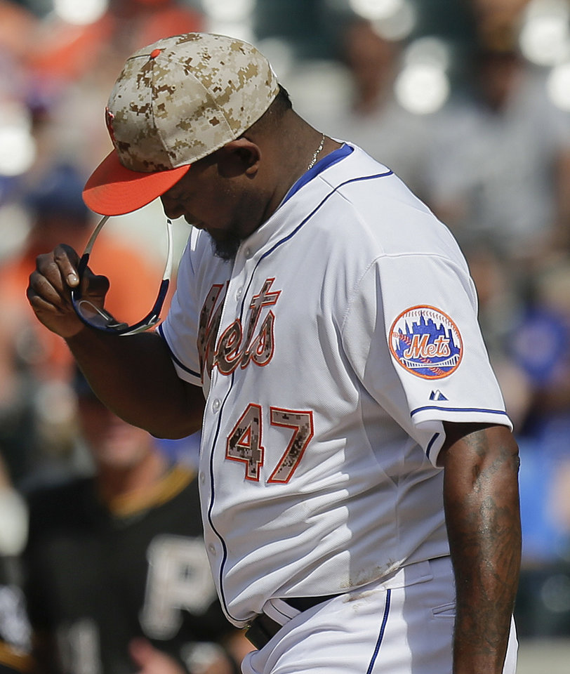 New York Mets pitcher Jose Valverde (47) adjusts his sunglasses after giving up an RBI base hit to Pittsburgh Pirates\' Jose Tabata during the eighth inning of a baseball game, Monday, May 26, 2014, in New York. The Pirates won 5-3. (AP Photo/Julie Jacobson)