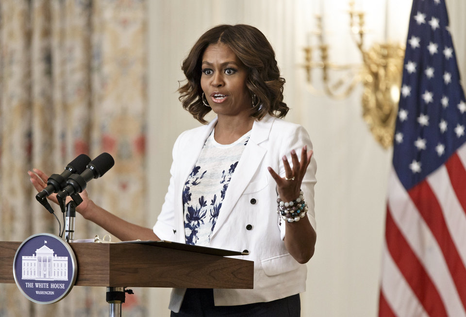 Photo - First lady Michelle Obama, a longtime supporter of healthier eating and physical fitness, expands her push for America to drink more water, at a