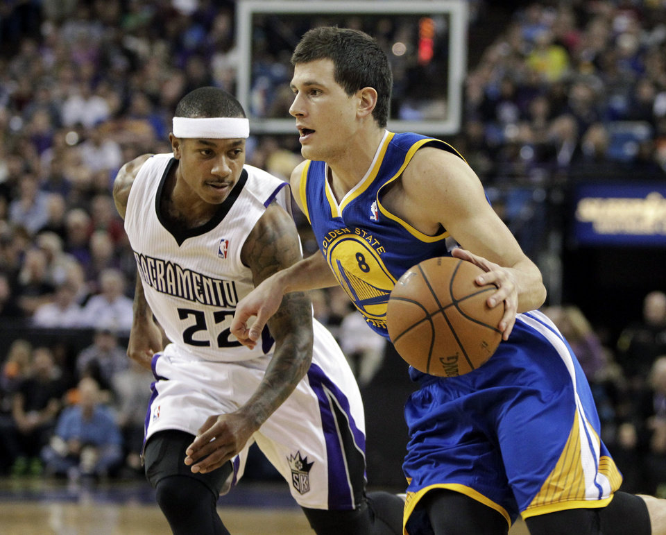 Photo - Golden State Warriors guard Nemanja Nedovic,  right, of Serbia, drives against Sacramento Kings guard Isaiah Thomas during the first quarter of an NBA basketball game in Sacramento, Calif., Sunday, Dec. 1, 2013. (AP Photo/Rich Pedroncelli)