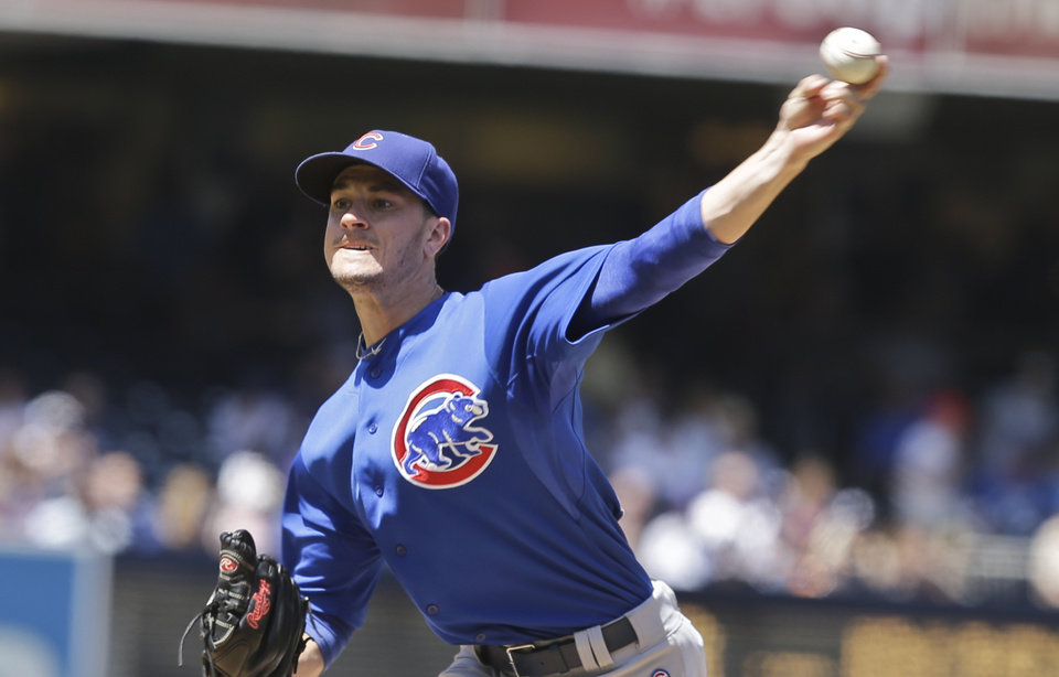 Photo - Chicago Cubs starting pitcher Chris Rusin throws against the San Diego Padres in the first inning of a baseball game Sunday, Aug. 25, 2013, in San Diego. (AP Photo/Lenny Ignelzi)
