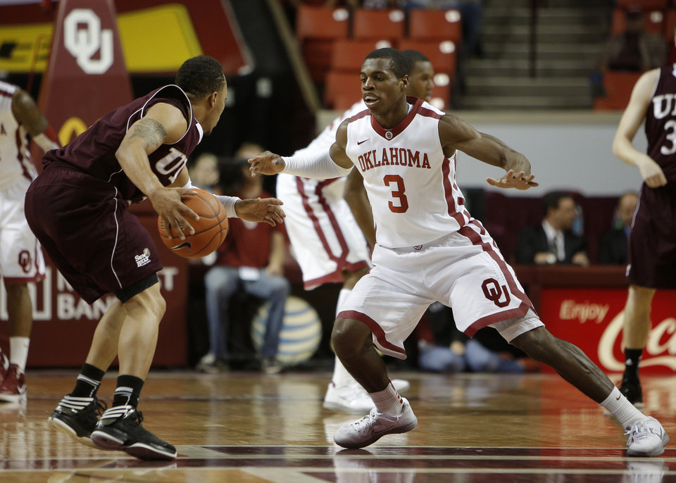 Photo - Oklahoma's Buddy Hield (3) guards Louisiana's Marcelis Hansberry (3) during a men's college basketball game between the University of Oklahoma and the University of Louisiana-Monroe at the Loyd Noble Center in Norman, Okla., Sunday, Nov. 11, 2012.  Photo by Garett Fisbeck, The Oklahoman
