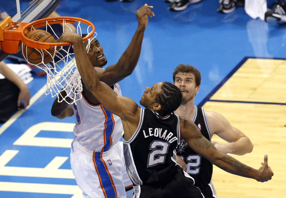 Photo - San Antonio's Kawhi Leonard (2) dunks in as Oklahoma City's Serge Ibaka (9) defends during Game 3 of the Western Conference Finals in the NBA playoffs between the Oklahoma City Thunder and the San Antonio Spurs at Chesapeake Energy Arena in Oklahoma City, Sunday, May 25, 2014. Photo by Nate Billings, The Oklahoman