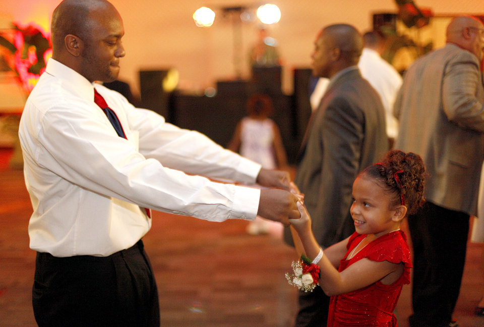 Kitrell Hill dances with his daughter Kayla, 7, during a Daddy-Daughter Dance, Saturday, Feb. 7, 2010, at the Reed Center in Midwest City, Okla. Photo by Sarah Phipps, The Oklahoman.