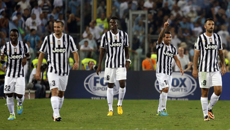 Juventus' Carlos Tevez, of Argentina, second right, celebrates with teammates after scoring during the Italian Supercup soccer match against Lazio at the Rome Olympic stadium Sunday, Aug. 18, 2013. (AP Photo/Gregorio Borgia)
