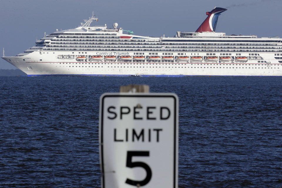 Photo - The cruise ship Carnival Triumph into Mobile Bay near Dauphin island, Ala., Thursday, Feb. 14, 2013.  The ship with more than 4,200 passengers and crew members has been idled for nearly a week in the Gulf of Mexico following an engine room fire. (AP Photo/Dave Martin)