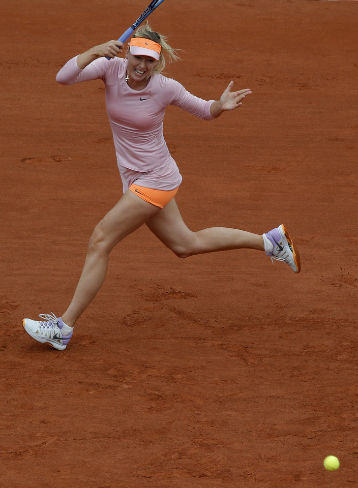 Photo - Russia's Maria Sharapova returns the ball to compatriot Ksenia Pervak during the first round match of  the French Open tennis tournament at the Roland Garros stadium, in Paris, France, Monday, May 26, 2014. (AP Photo/Michel Euler)