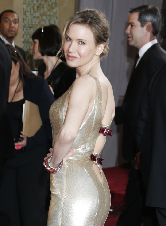 Photo - Actress Renée Zellweger arrives at the Oscars at the Dolby Theatre on Sunday Feb. 24, 2013, in Los Angeles. (Photo by Todd Williamson/Invision/AP)