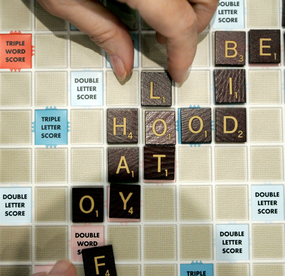 People place letters on a Scrabble board during the Edmond Senior Center Scrabble group, Wednesday, July 13, 2005.  By Bryan Terry/The Oklahoman