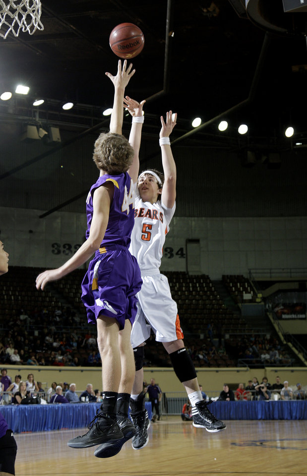 Cheyenne-Reydon's Dylan Moler shoots over Weleetka's Caleb Wittman in the Class A boy's semi final game between Cheyenne-Reydon and Weleetka at the State Fair Arena in  Oklahoma City,  Friday, March 2, 2012. Photo by Sarah Phipps, The Oklahoman