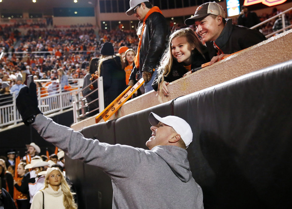 Photo - Former OSU quarterback Brandon Weeden takes a selfie with fans before the Bedlam college football game between the Oklahoma State Cowboys (OSU) and Oklahoma Sooners (OU) at Boone Pickens Stadium in Stillwater, Okla., Saturday, Nov. 30, 2019. [Nate Billings/The Oklahoman]