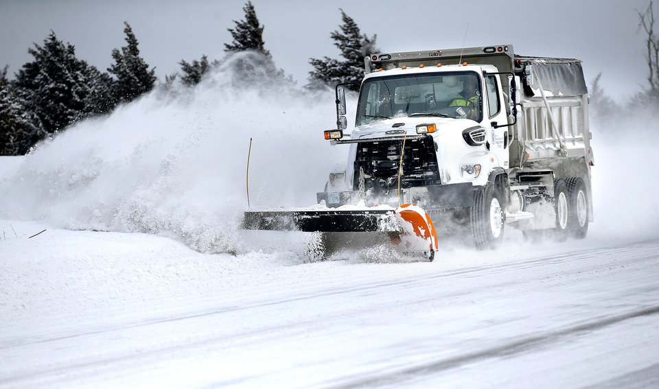 Photo - A snow plow clears NW 164 in Oklahoma City, Wednesday, Feb. 17, 2021. [Sarah Phipps/The Oklahoman]