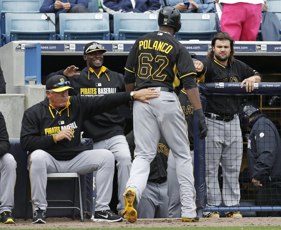 Photo - Pittsburgh Pirates right fielder Gregory Polanco (62) is greeted by teammates after hitting a home run during the first inning of an exhibition baseball game against the New York Yankees Thursday, Feb. 27, 2014, in Tampa, Fla. (AP Photo/Charlie Neibergall)