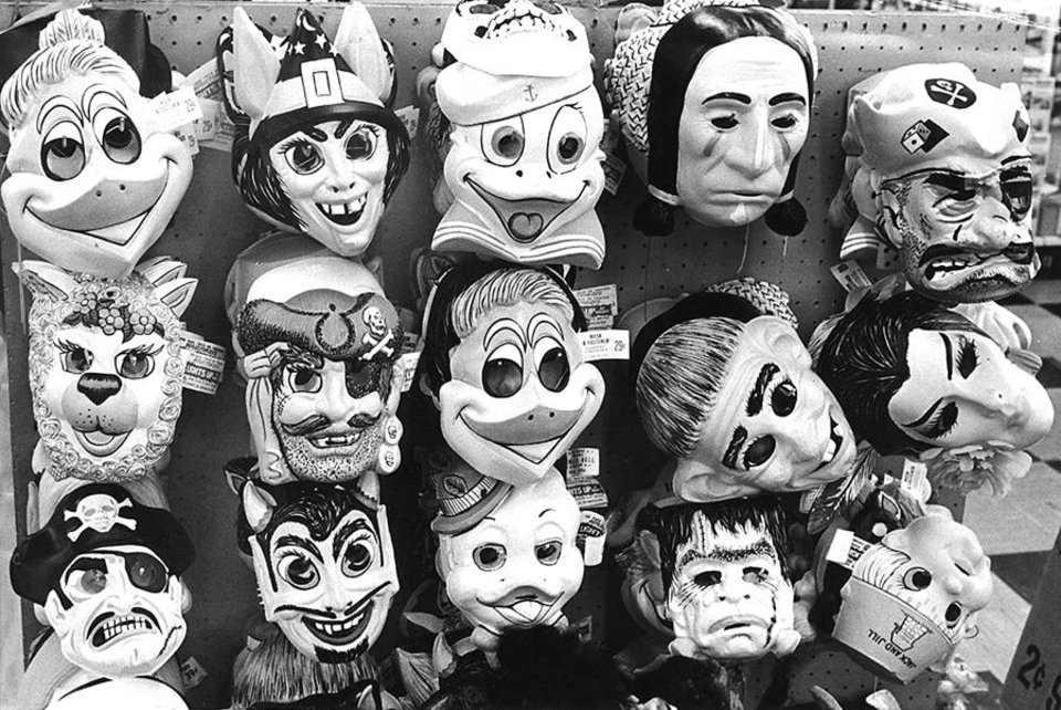 Photo -  **For Alternate Crop** Racks of Halloween masks await local goblins who will spend Halloween dressed as witches, devils or clowns. Photographed Oct. 12, 1973. Archive Photo by Bob Albright