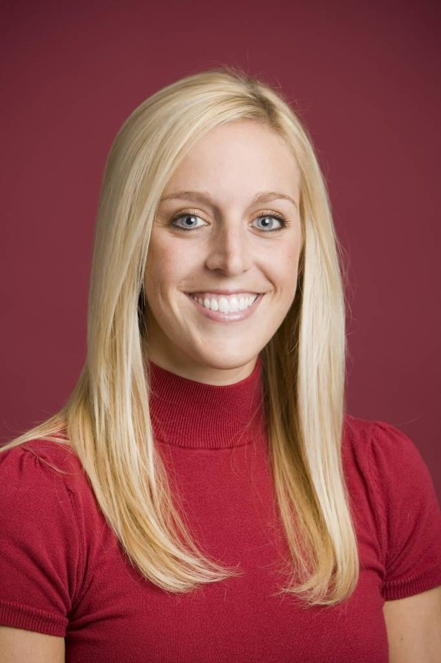Photo -   FILE - In this undated image released by the University of Arkansas, Razorback Foundation assistant director Jessica Dorrell poses for a photo. Arkansas has fired Bobby Petrino as football coach on Tuesday, saying he engaged in reckless behavior. The 51-year-old Petrino was injured in an April 1 motorcycle accident. He was put on paid leave last week after admitting he lied about the presence of the 25-year-old employee, Dorrell, who had been riding with him. (AP Photo/University of Arkansas, Wesley Hitt, File)