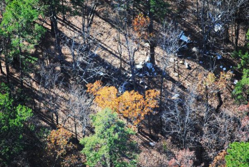 At left: An aerial photo near Perryville, Ark., shows the site of the plane crash that killed Oklahoma State University women's basketball head coach Kurt Budke and his assistant coach, Miranda Serna, along with Olin and Paula Branstetter.  Photo by Scott Munsell, KATV Channel 7