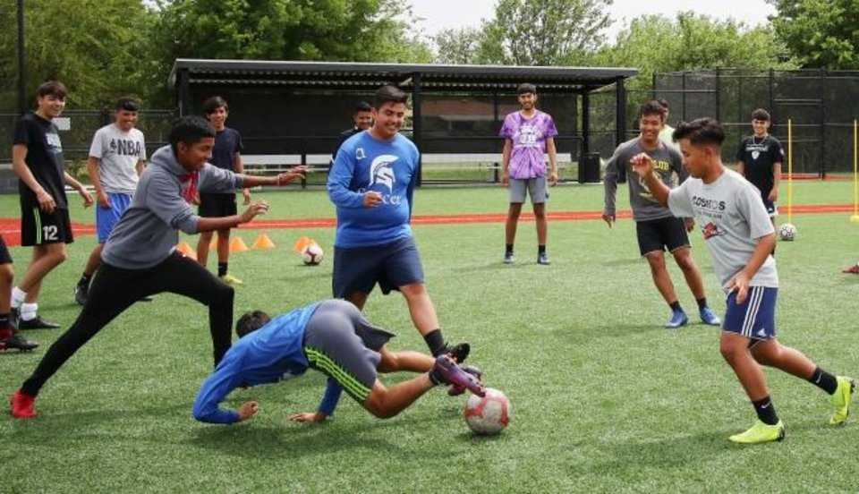 Photo -  The Southeast High School soccer team enjoys a drill during practice at the south Oklahoma City school.