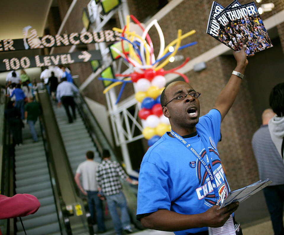 Photo - Dean Taylor passes out programs and sells magazines to fans as they enter the OKC Arena before the first round NBA Playoff basketball game between the Oklahoma City Thunder and the Denver Nuggets at OKC Arena in downtown Oklahoma City on Wednesday, April 20, 2011. Photo by John Clanton, The Oklahoman