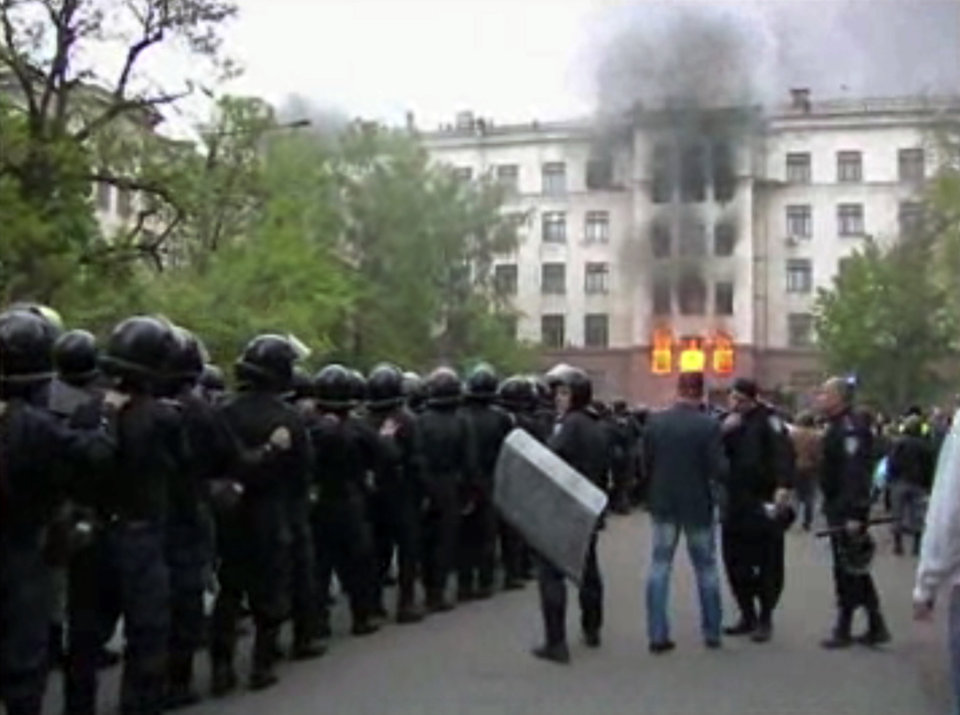 Photo - This image made from AP video shows a building on fire in Odessa, Ukraine, on Friday, May 2, 2014. Deadly clashes took place in the southern Ukraine port of Odessa on Friday, triggered by Ukraine's offensive to recapture the eastern city of Slovyansk from pro-Russia forces. (AP Photo via AP Video)