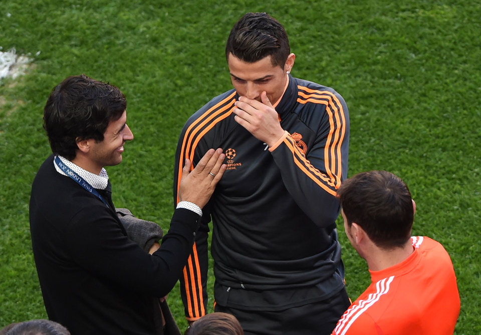 Photo - Former Real player Raul Gonzalez, left, laughs with Real's Cristiano Ronaldo, centre, and Real goalkeeper Iker Casillas, during a training session ahead of Saturday's Champions League final soccer match between Real Madrid and Atletico Madrid, in Luz stadium in Lisbon, Portugal, Friday, May 23, 2014. (AP Photo/Paulo Duarte)