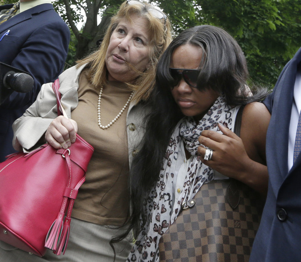 Photo - Shayanna Jenkins, right, fiancee of former New England Patriots football player Aaron Hernandez, is escorted by attorney Janice Bassil after a bail hearing in Fall River Superior Court Thursday, June 27, 2013 in Fall River, Mass. Hernandez, charged with murdering Odin Lloyd, a 27-year-old semi-pro football player, was denied bail. (AP Photo/Elise Amendola)