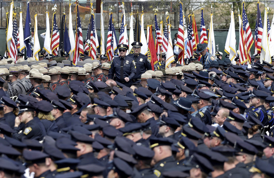 Police officers arrive to a memorial service for fallen Massachusetts Institute of Technology campus officer Sean Collier at MIT in Cambridge, Mass. Wednesday, April 24, 2013.  Authorities say Collier was killed by the Boston Marathon bombing suspects last Thursday, April 18. He had worked for the department a little more than a year.  (AP Photo/Elise Amendola)