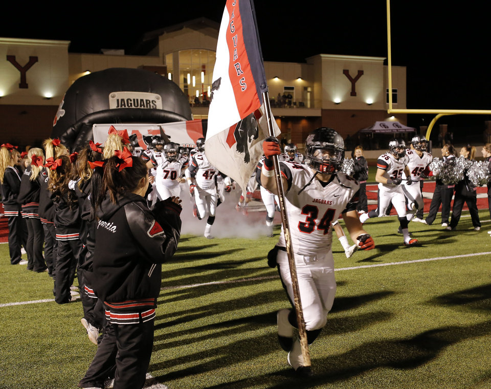 Photo - Westmoore team comes onto field during the 6A high school playoff game between Westmoore and Jenks at Yukon High School Friday November 29, 2013. Photo by Doug Hoke, The Oklahoman
