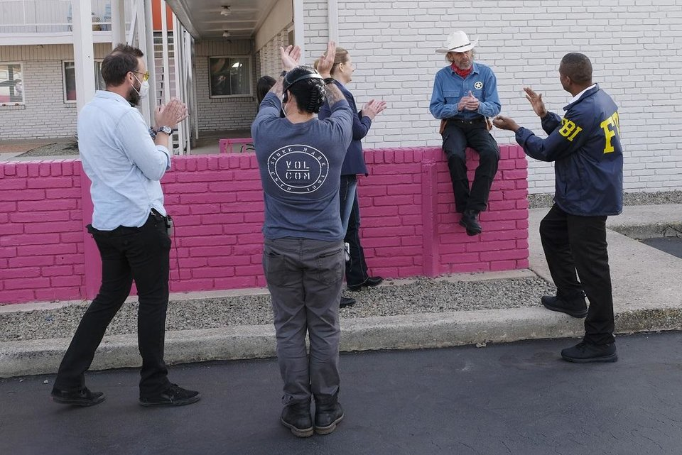 Photo - Cast and crew celebrate after wrapping up actor Luce Rains', center, final scene on the set of the Oklahoma film