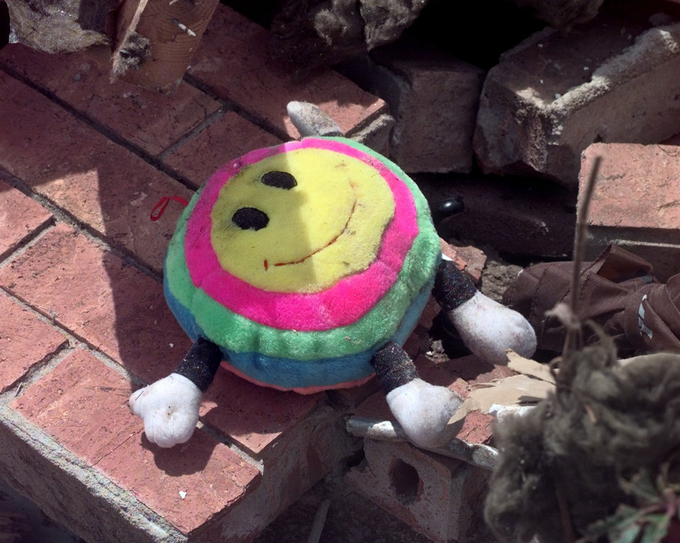 MAY 3, 1999 TORNADO: Kids toy in the rubble of Monday night's tornado damage in Moore. (Items in tornado aftermath)